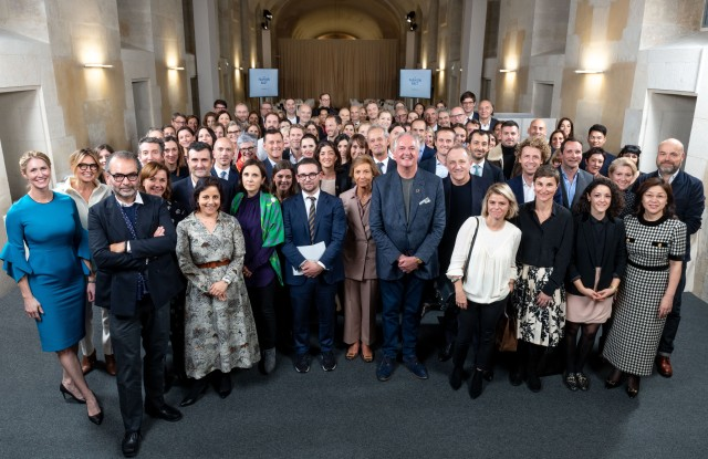 Representatives of the Fashion Pact signatories at a working meeting in Paris.