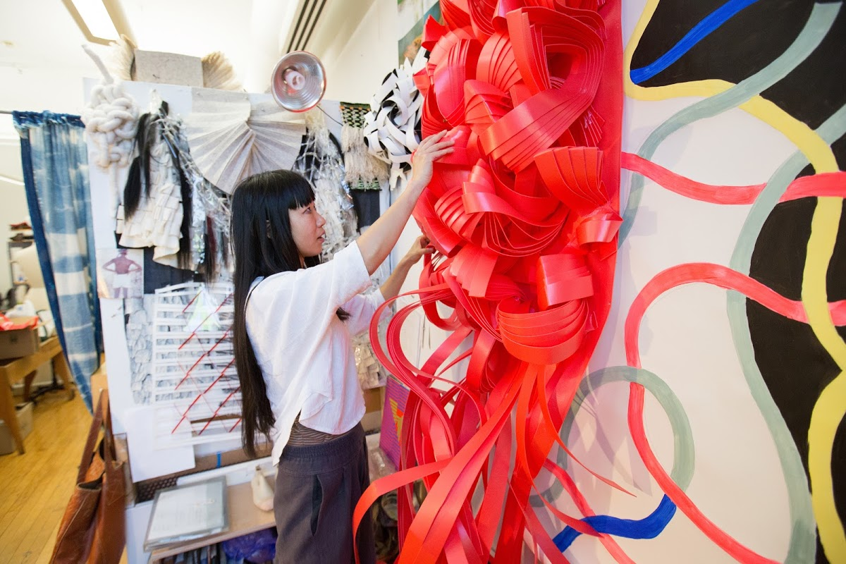 A RISD student works with textiles.