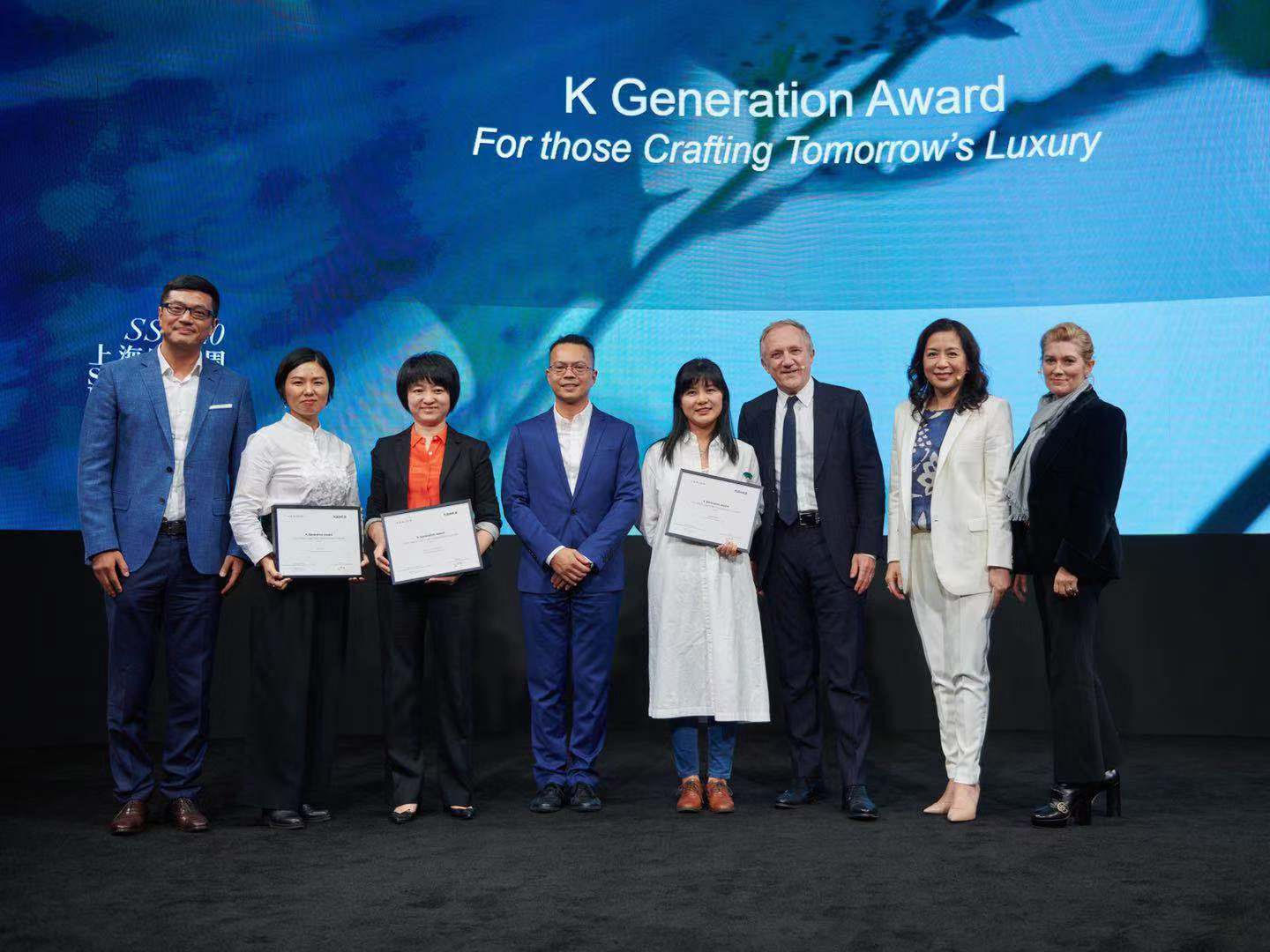 Winners of the K Generation Award with executives from Kering and Plug and Play.