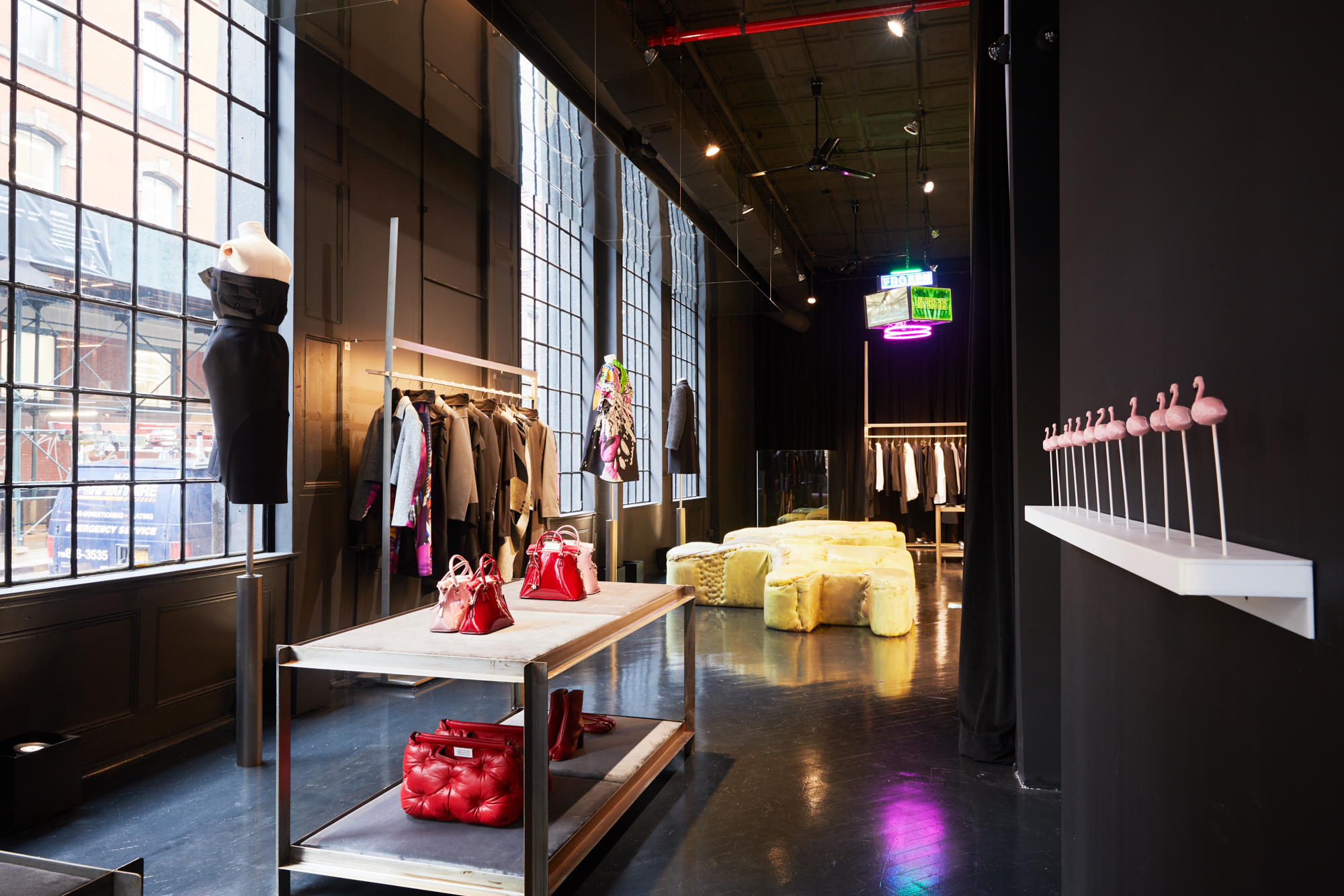 Maison Margiela's new Transitory Concept store with Jessi Reaves' functional sculpture in the background and Tabor Robak's mini Jumbotron hanging from the ceiling.