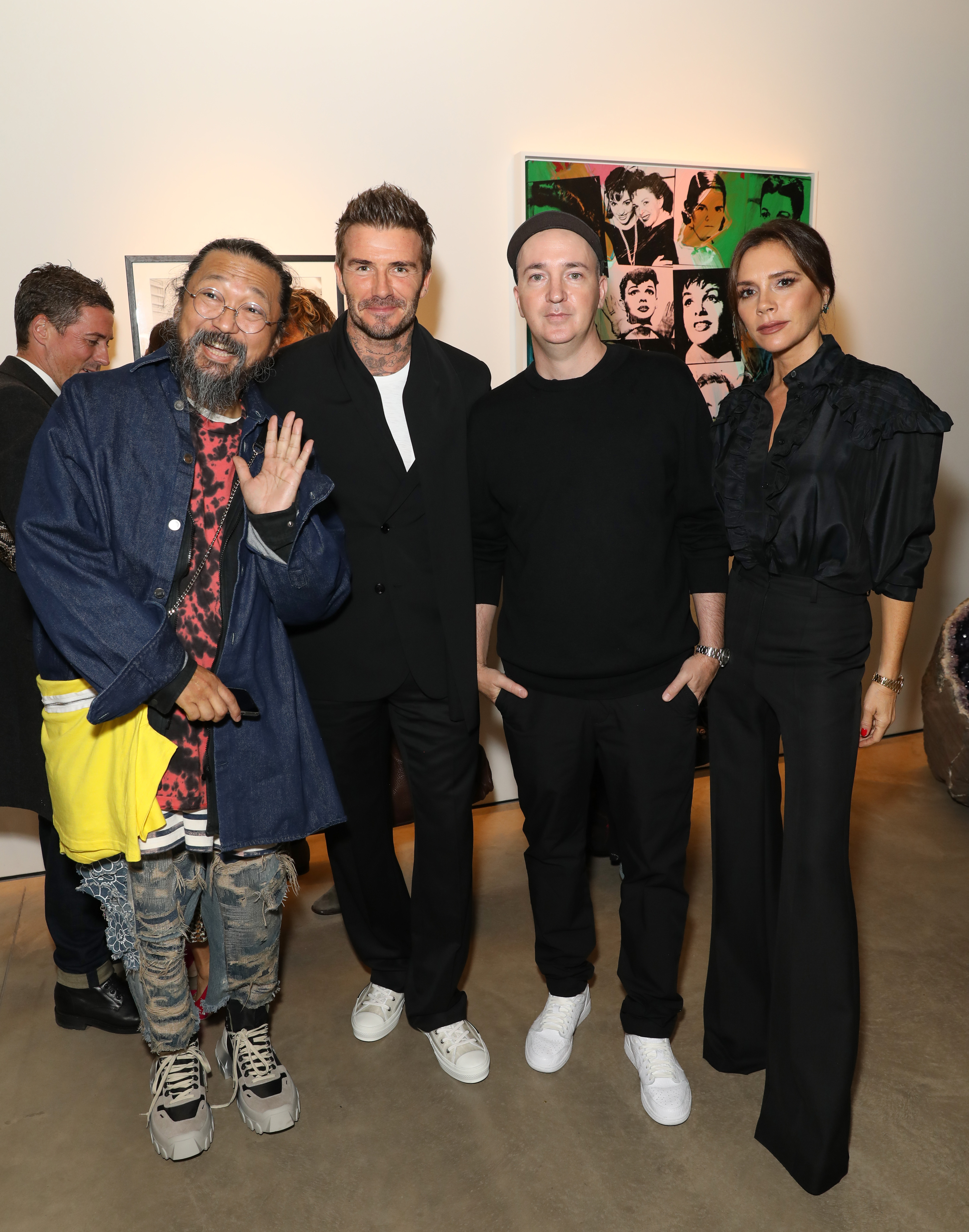 (L-R) Takashi Murakami, David Beckham, Brian Donnelly aka Kaws and Victoria Beckham attend Victoria Beckham and Sotheby's celebration of Andy Warhol with Don Julio 1942 at her Dover Street store.