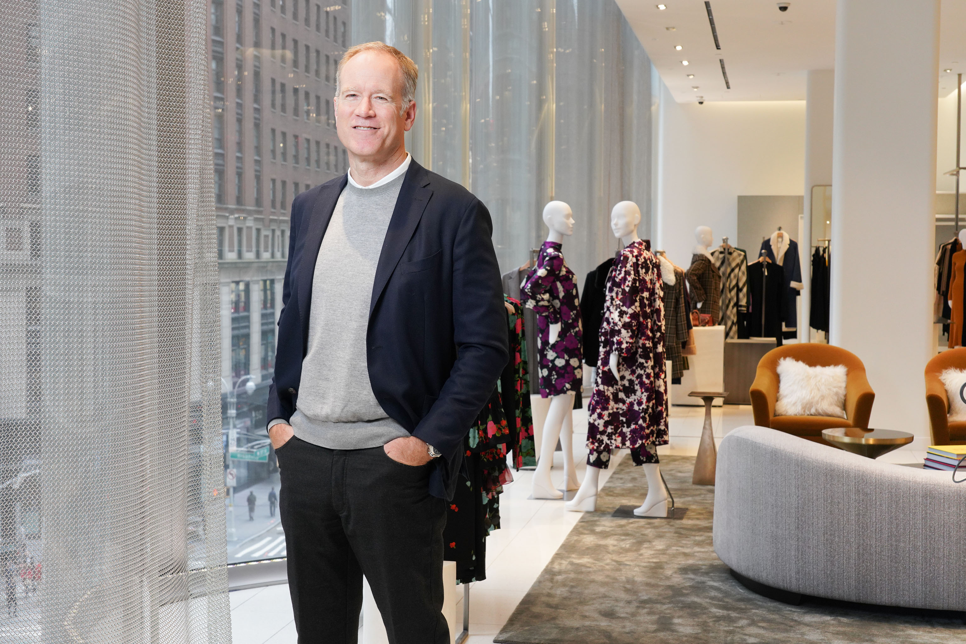 Pete Nordstrom by the undulating glass façade at the 57th Street flagship.