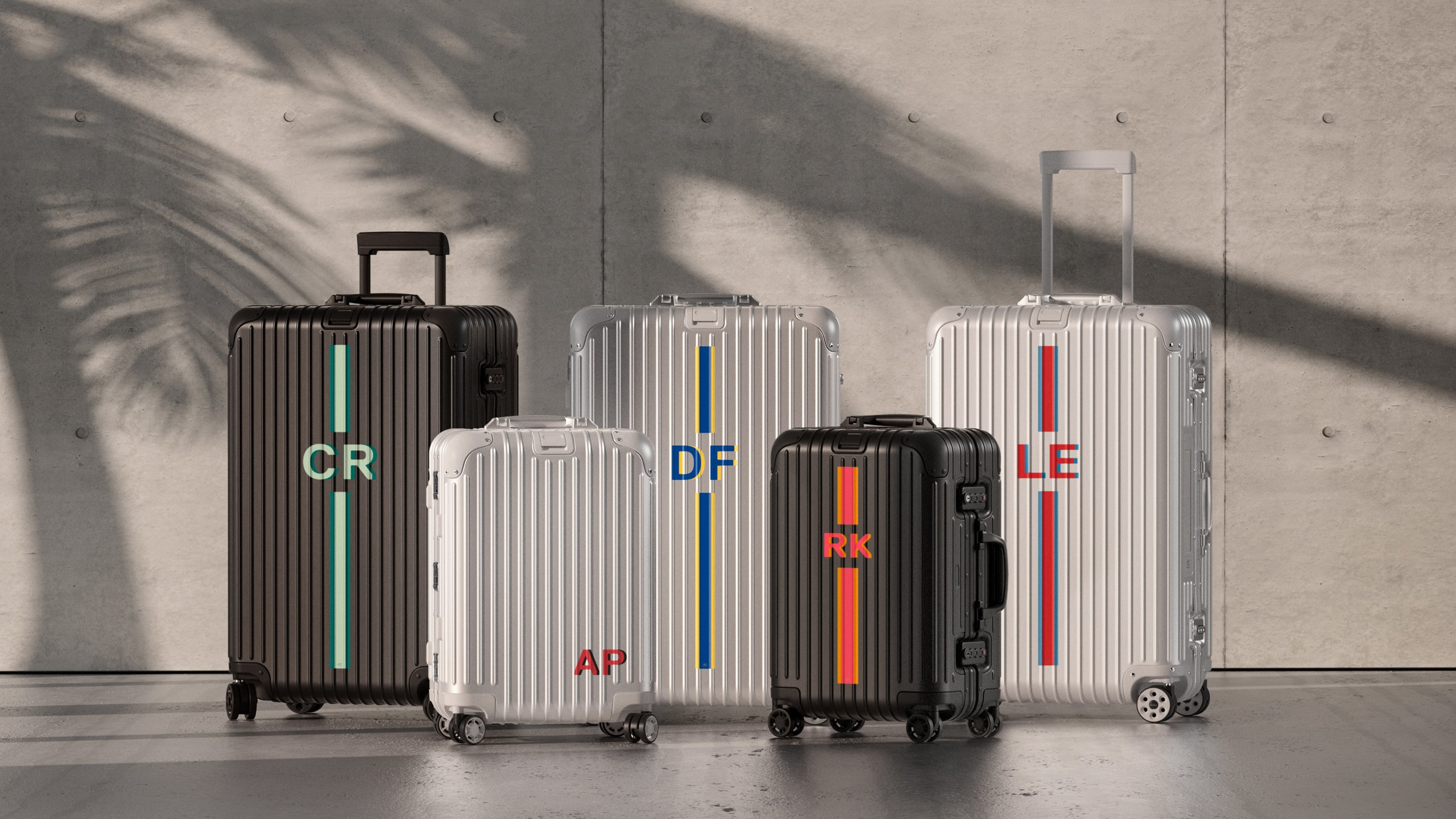 Sticker sets by Premium Economy on hard shell suitcases