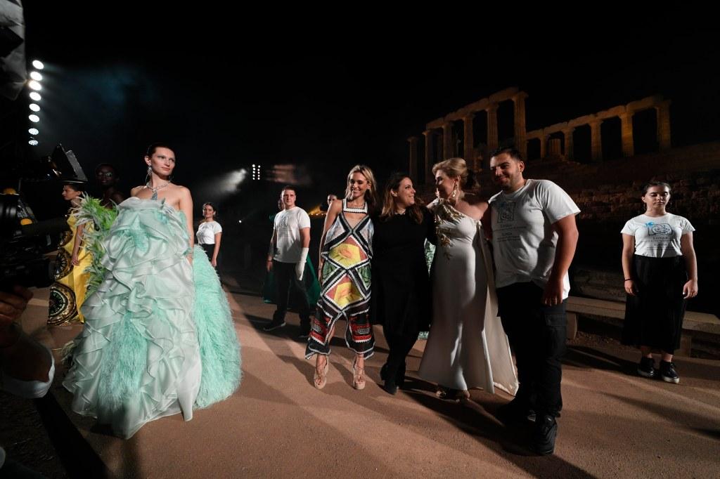 Mary Katrantzou takes her bow with the Vardinoyannis family