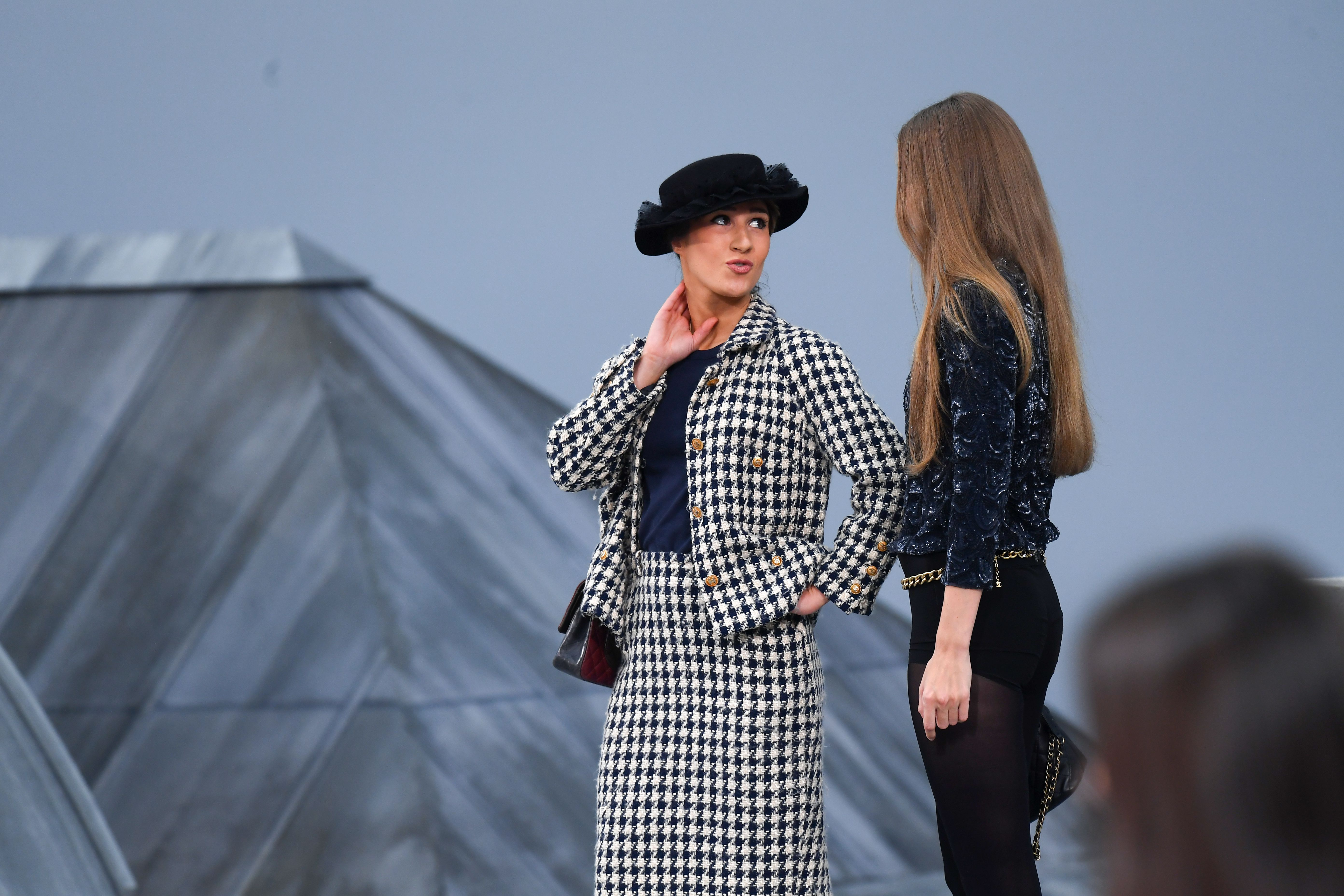 Gigi Hadid approaches a woman during the finale and escorts her off the catwalkChanel show, Runway, Spring Summer 2020, Paris Fashion Week, France - 01 Oct 2019