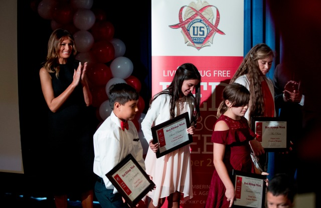 First lady Melania Trump, left, applauds art student awardees at a Red Ribbon Rally at the Drug Enforcement Agency in Arlington, VaMelania Trump, Arlington, USA - 07 Oct 2019