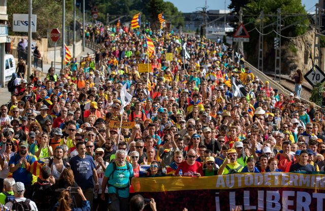 Catalan pro-independence demonstrators march as they arrive at Arenys de Mar, near Girona, Spain, . Thousands of people have joined five large protest marches across Catalonia that are set to converge on Barcelona, as the restive region reels from three straight days of violent clashes between police and protesters. The marches set off from several Catalan towns and aimed to reach the Catalan capital by FridayCatalonia, Arenys de Mar, Spain - 17 Oct 2019