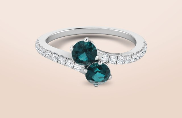A diamond and emerald ring from JewelryPass.