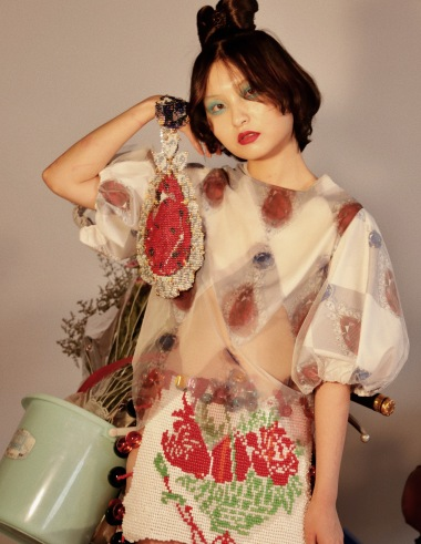 A look from Qi's presentation which includes her signature style beaded skirt and purse mixed with retro Chinese motifs.