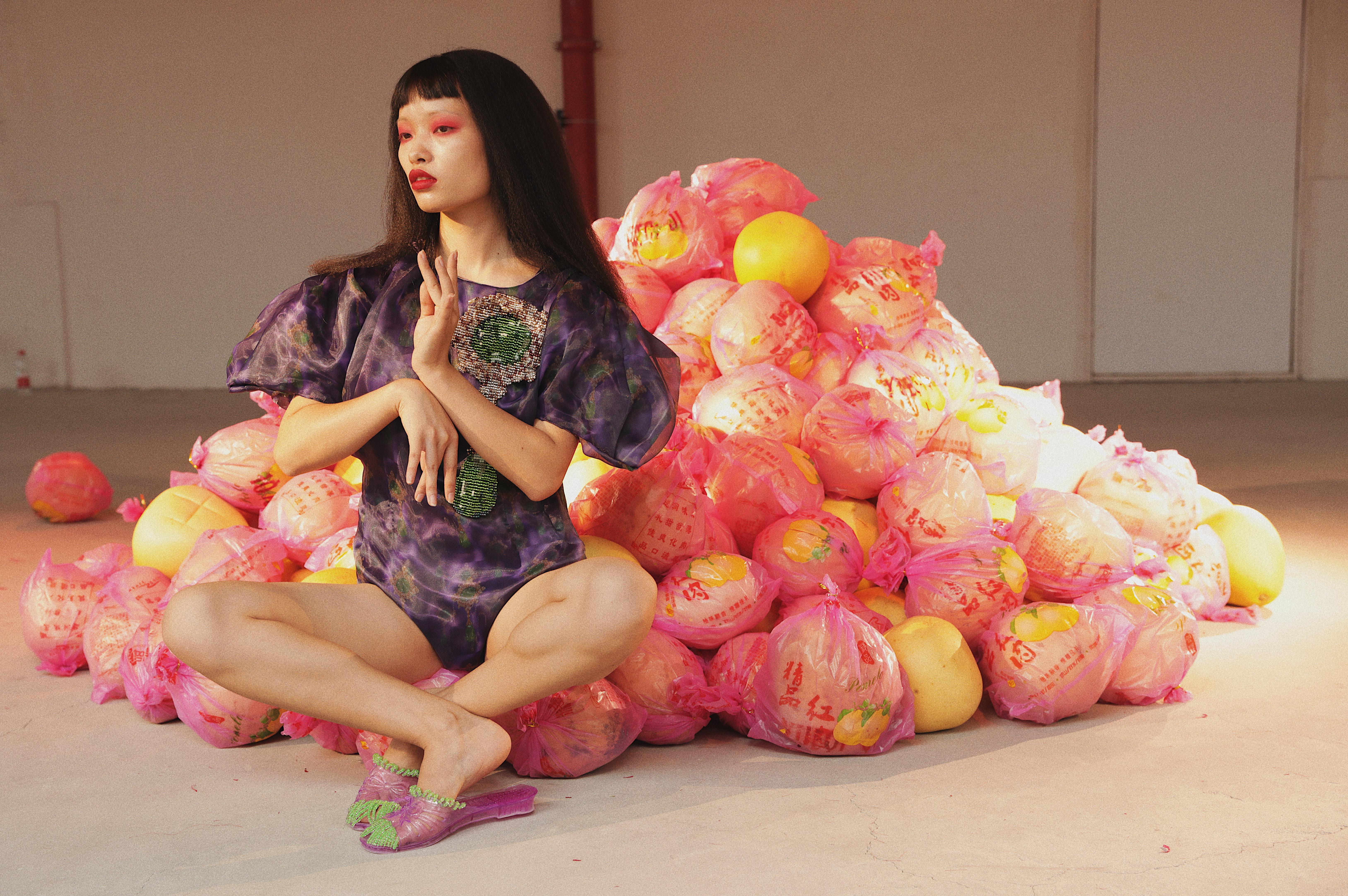 Models walked slowly around a pile of pomelos, which showgoers took home later as a gift.