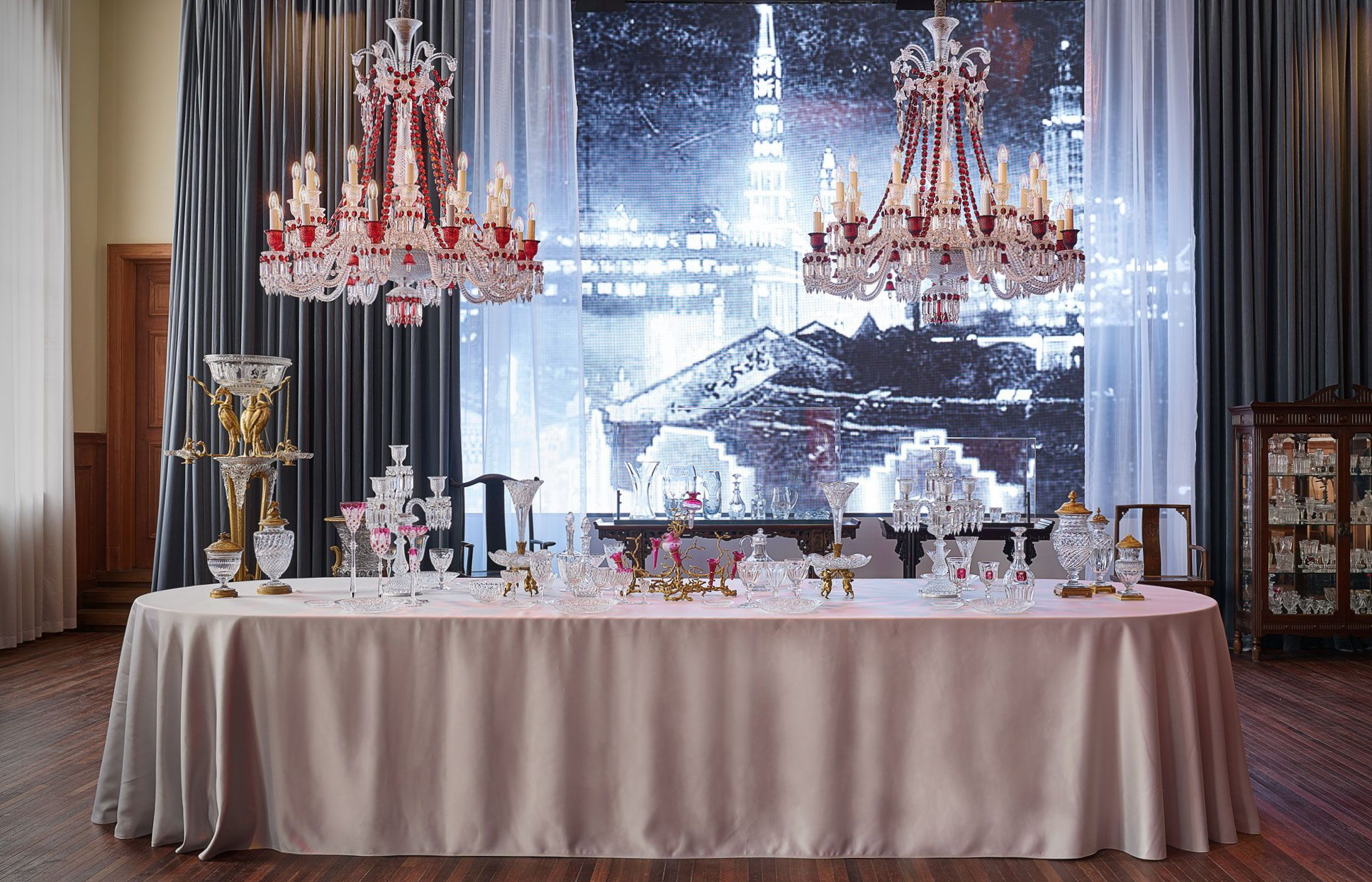 A table setting with chandeliers in the Baccarat Shanghai exhibition.