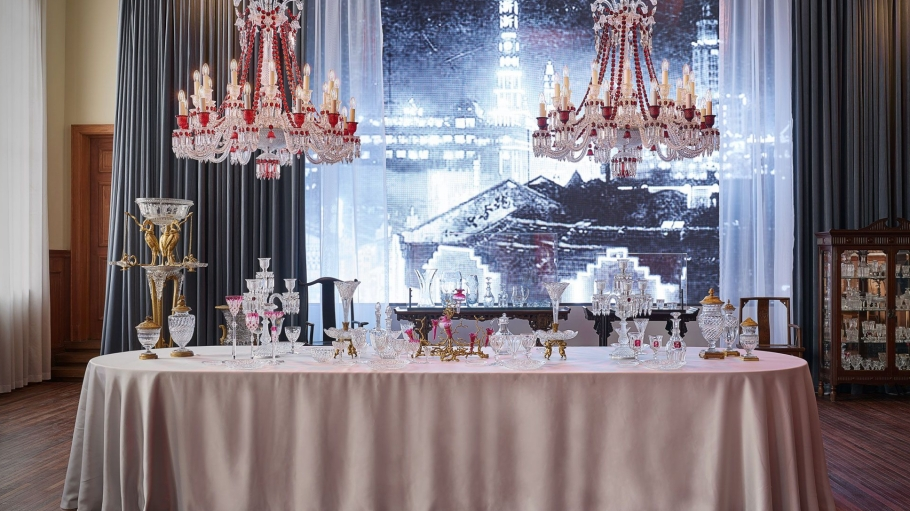 A table setting with chandeliers in