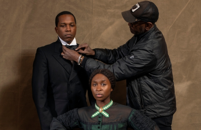 4130_D031_00152_RCActors Leslie Odom Jr. and Cynthia Erivo with Costume Designer Paul Tazewell on the set of HARRIET, a Focus Features release. Credit: Glen Wilson / Focus Features