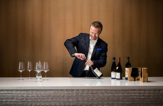 Sommelier Aldo Sohm conducting a wine tasting in the dining room of Prive by Le Bernardin, NYC