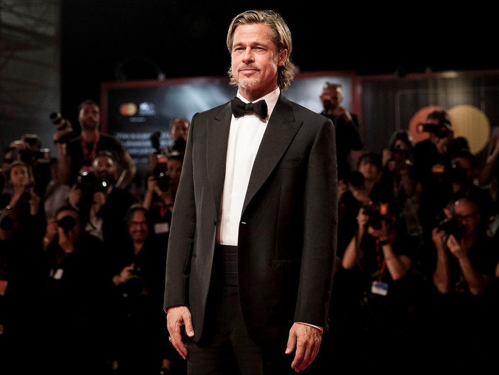 Brad Pitt wearing a Brioni black bespoke tuxedo at the 2019 Venice Film Festival.