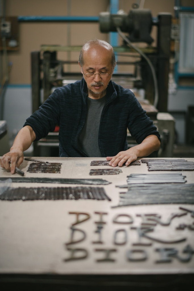 A Japanese craftsman works on a Dior print designed in collaboration with Shawn Stussy.