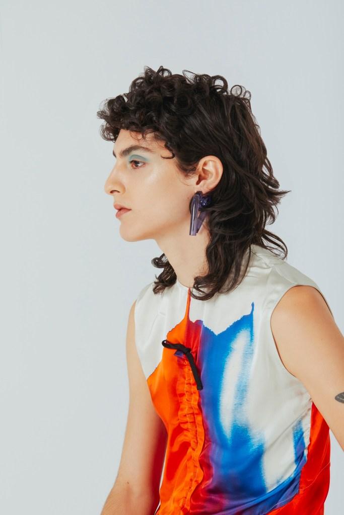 Colville dress; Mounseur earring.
