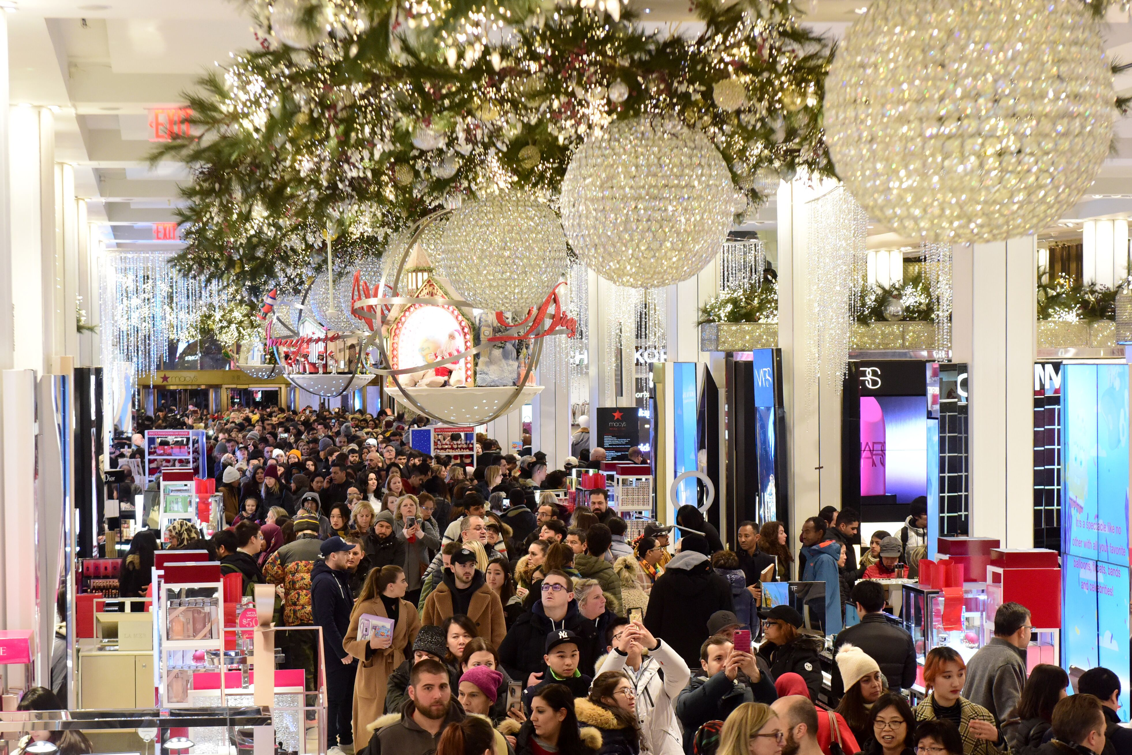 Shoppers surge into Macy's Herald Square at the 5 p.m. Thanksgiving Day opening.