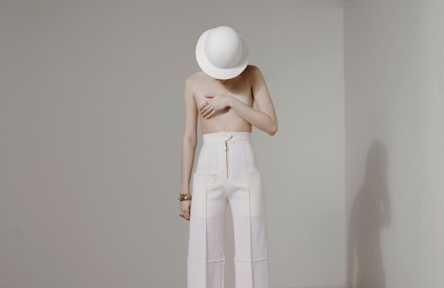 Louis VuittonÕs wool pants and hat. Givenchy shoes; Ariana Boussard-Reifel cuff; Isabel Bonner ring; Ali Grace ring.