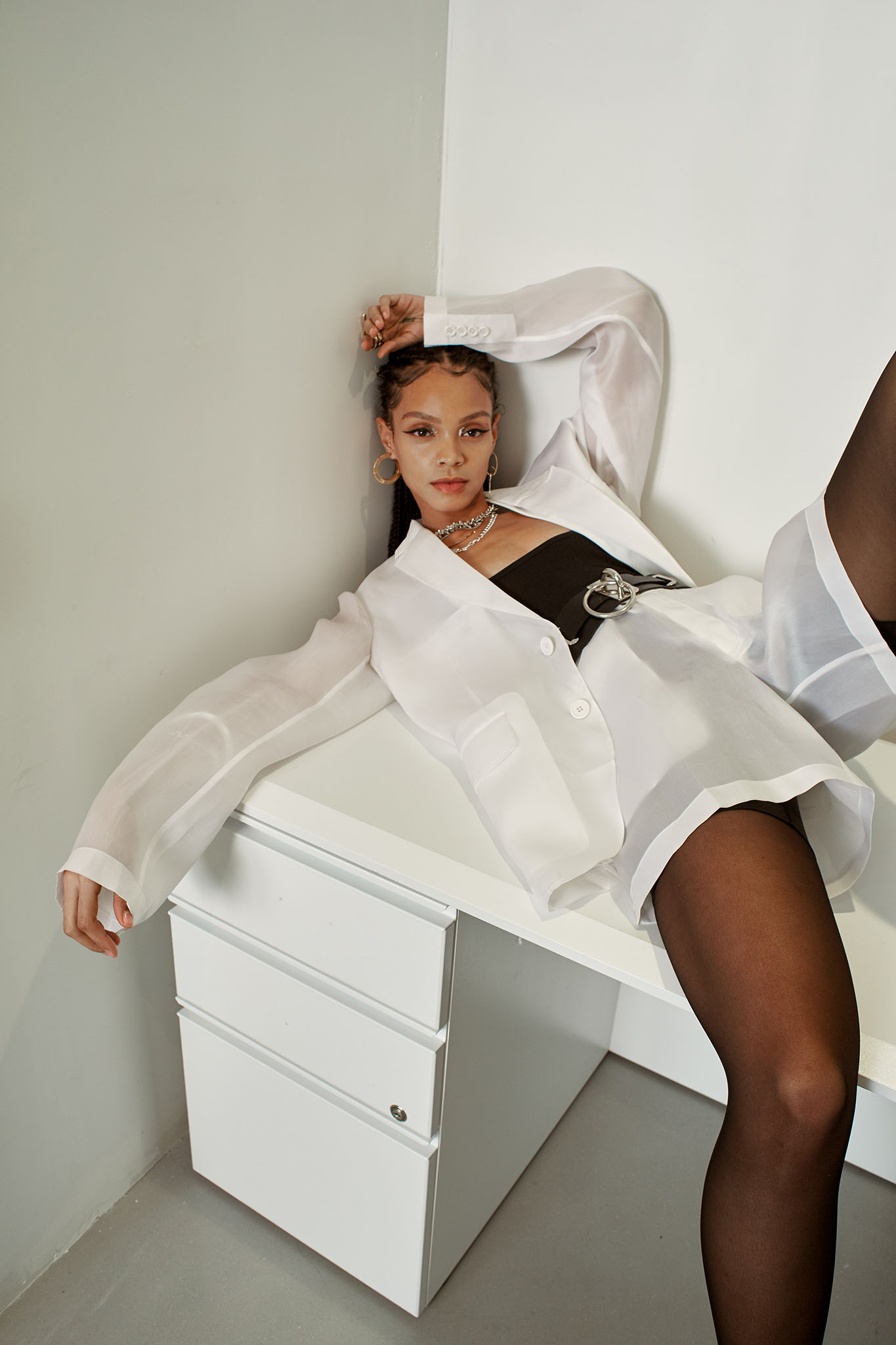Helmut Lang's silk organza blazer and shorts over Skims' nylon and spandex bodysuit. Gaviria earrings; Jessica Biales necklace; Mounser necklace; Zana Bayne belt; Calzedonia tights.