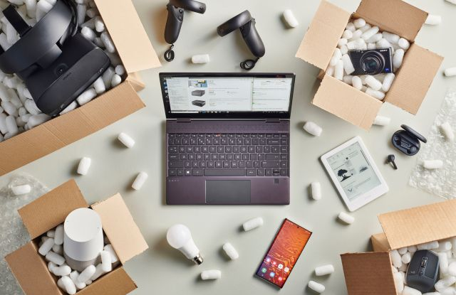 Editorial Use onlyMandatory Credit: Photo by Neil Godwin/Future/Shutterstock (10444724n)A Group Of Black Friday Online Shopping Purchases Photographed In Delivery Boxes Filled With Polystyrene Packing PelletsApple Watch Series 5 - 20 Sep 2019