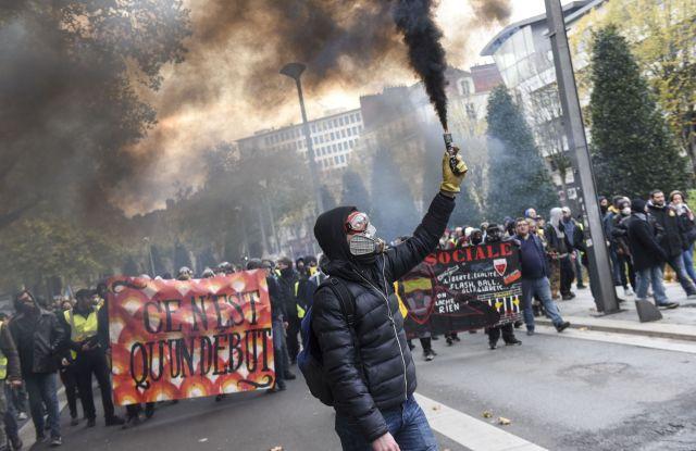 A protestor waves a flareGilets Jaunes anniversary protest, Nantes, France - 16 Nov 2019