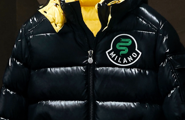 A Moncler puffer with a crest dedicated to Milan.