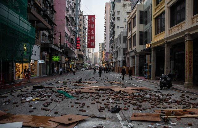 A street in Mong Kok is blocked with wooden boards, trash and bricks during the protest Protests in Hong Kong