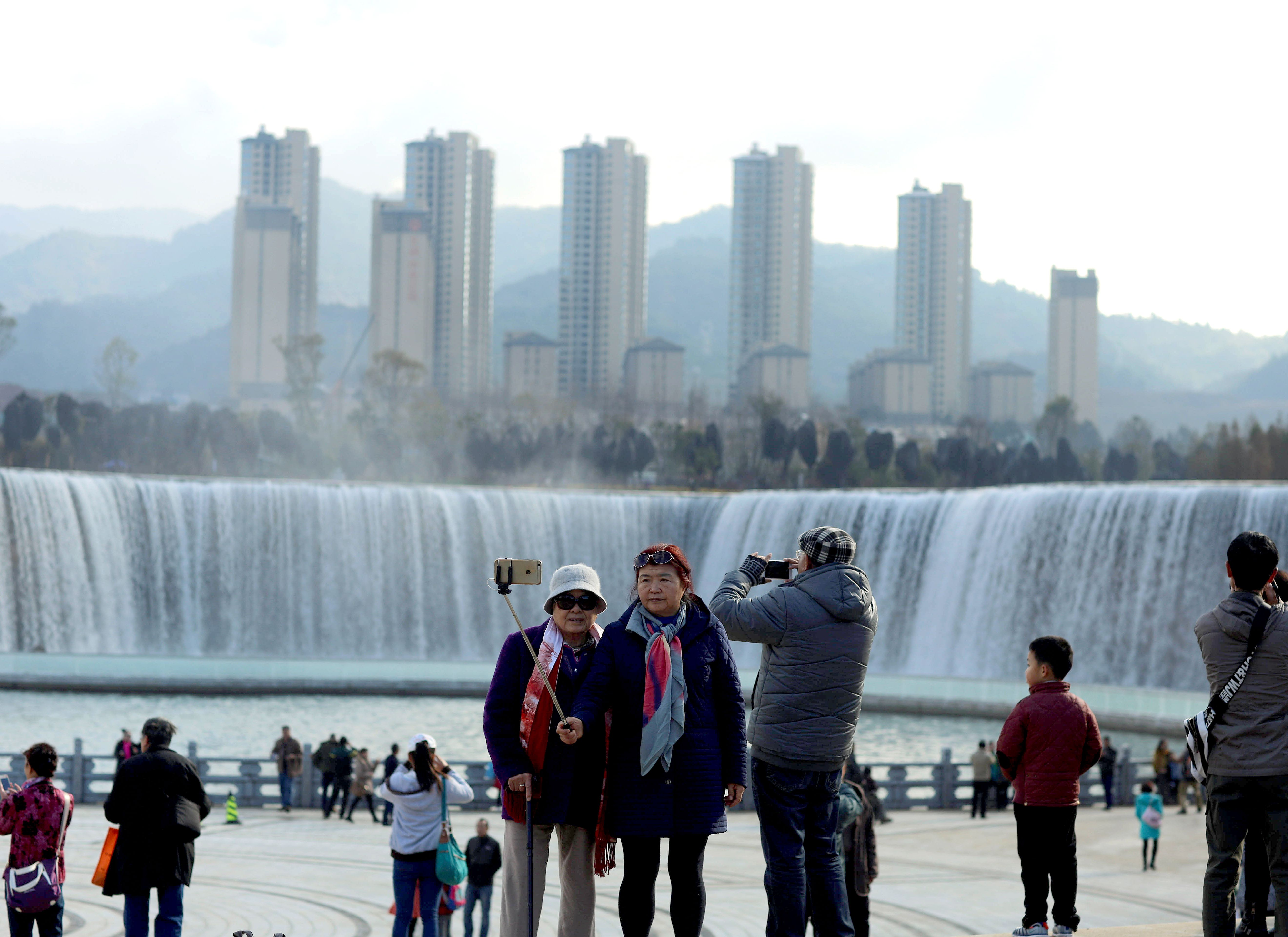 Visitors in front of Asia's largest man-made waterfall in Kunming, China.