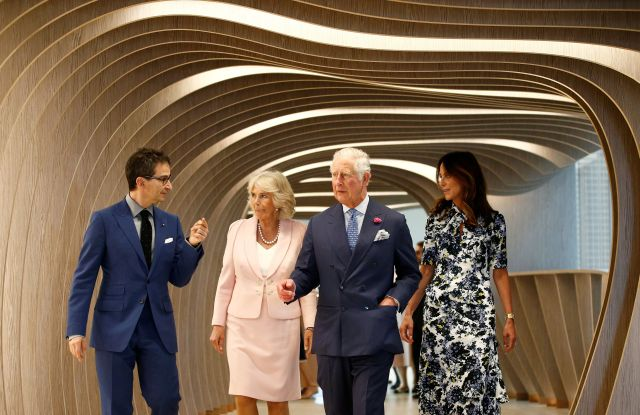 Britain's Prince Charles and Camilla Duchess of Cornwall, tour the new Tech Hub, with Chief Executive of Yoox Net-a-Porter Group Federico Marchetti and Alison Loehnis, President of Net-a-Porter.