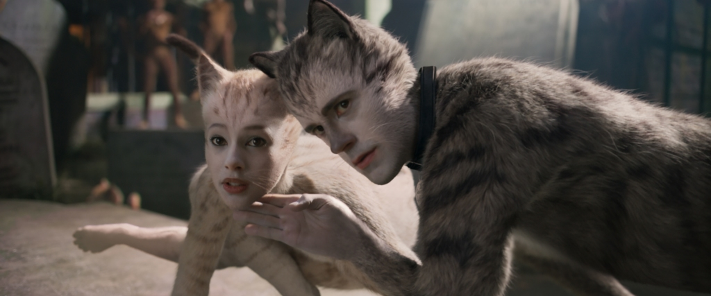 "(from left) Victoria (Francesca Hayward) and Munkustrap (Robbie Fairchild) in ""Cats,"" co-written and directed by Tom Hooper."