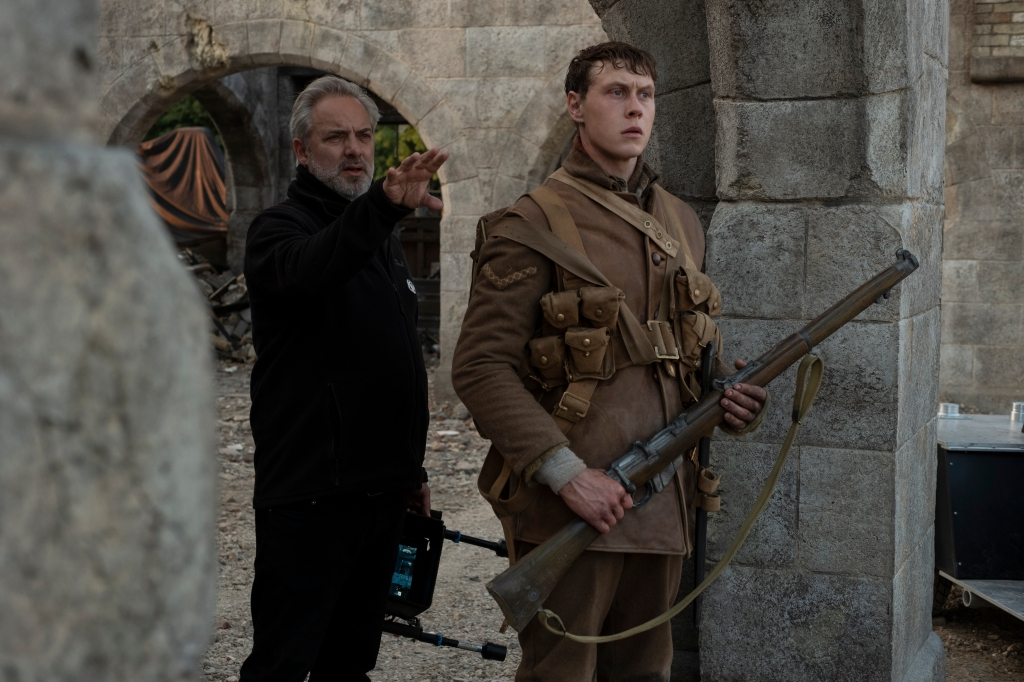 "(from left) Director Sam Mendes and George MacKay on the set of Mendes' new epic, ""1917."""