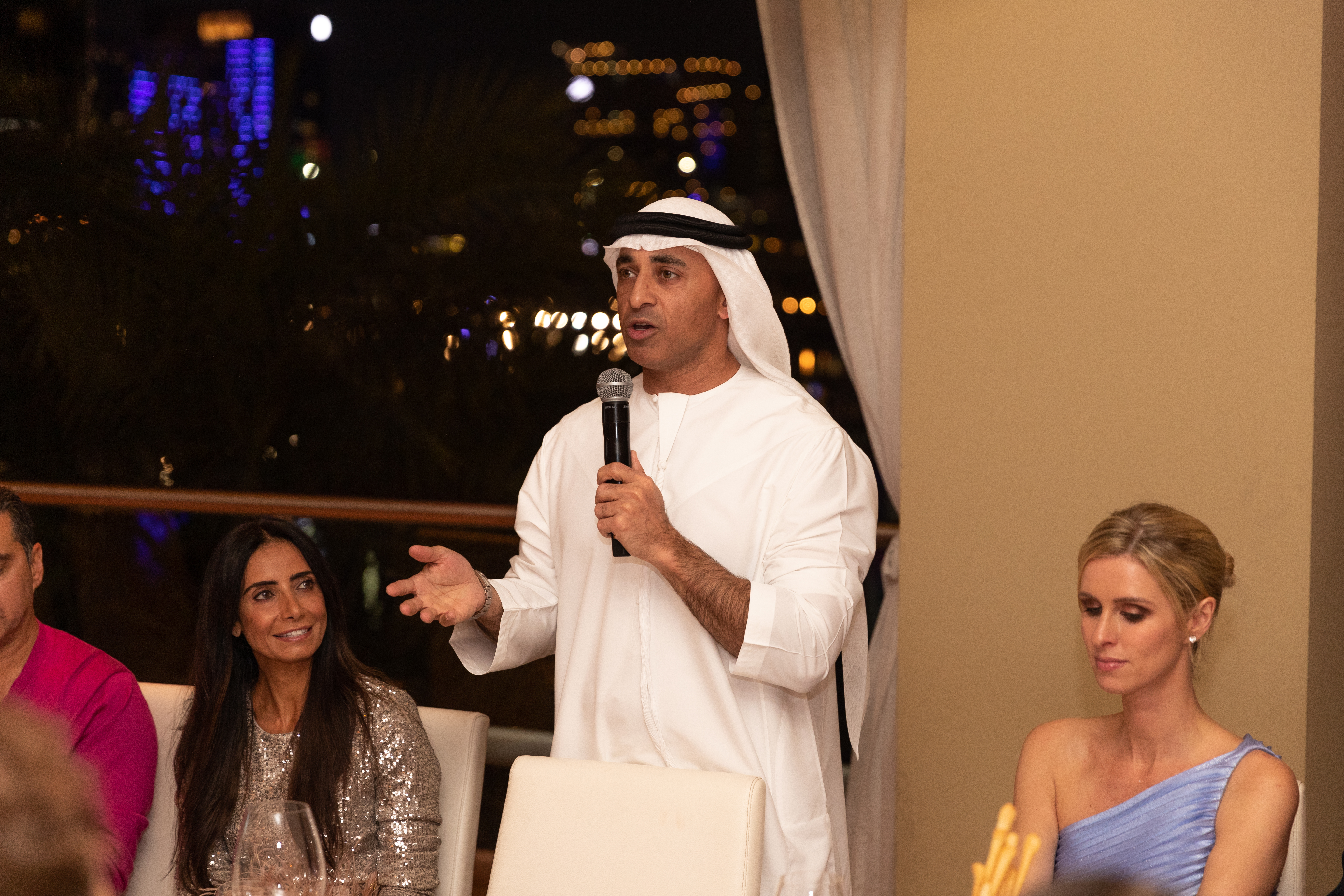 Emirati Ambassador to the U.S. Yousef Al Otaiba, flanked by his wife Abeer Al Otaiba and Nicky Hilton Rothschild, wearing Semsem.