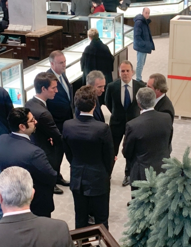 Bernard Arnault flanked by LVMH and Tiffany executives.
