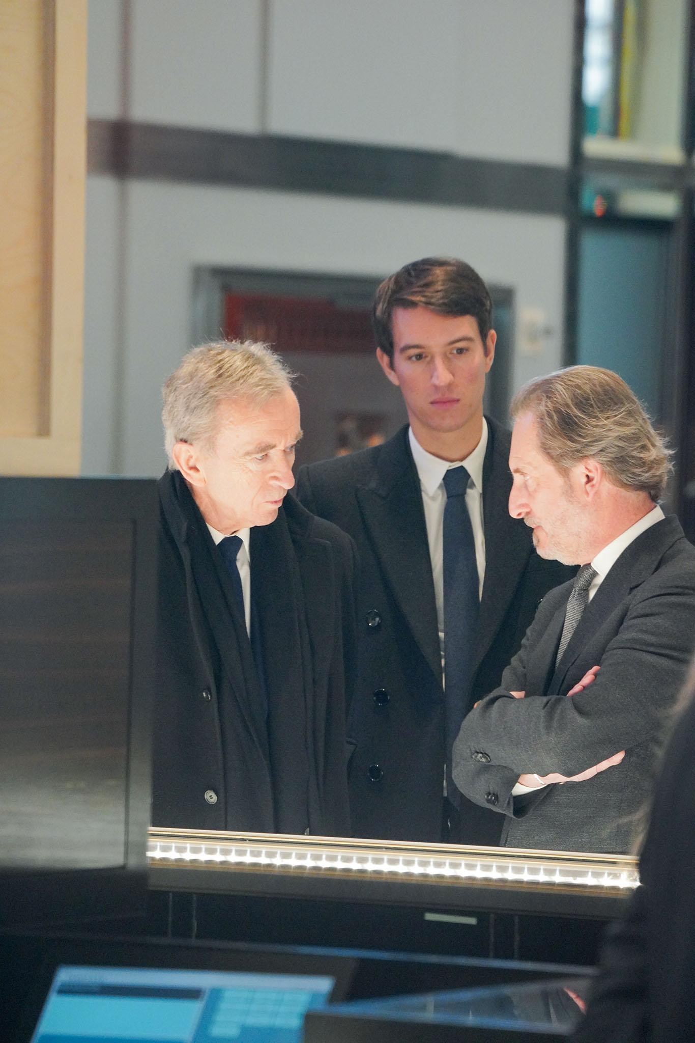 Bernard Arnault Alexandre Arnault Alessandro Bogliolo talking at Tiffany store.