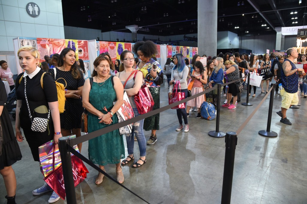 Festivalgoers line up for freebies and a look inside Sally Beauty's booth at Beautcon LA 2019.