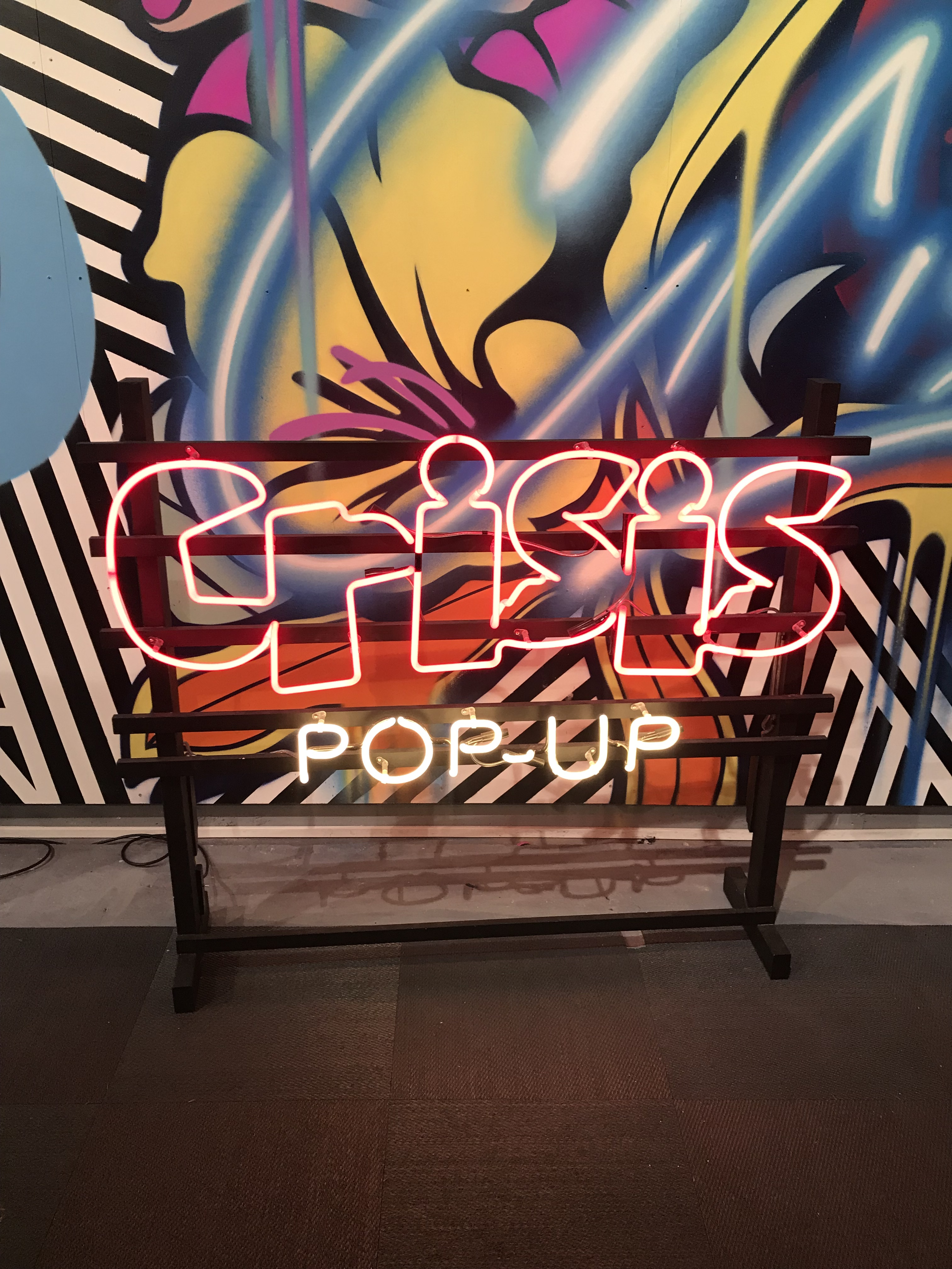 The street artist Ben Eine has done the interiors of the Savile Row pop-up shop.