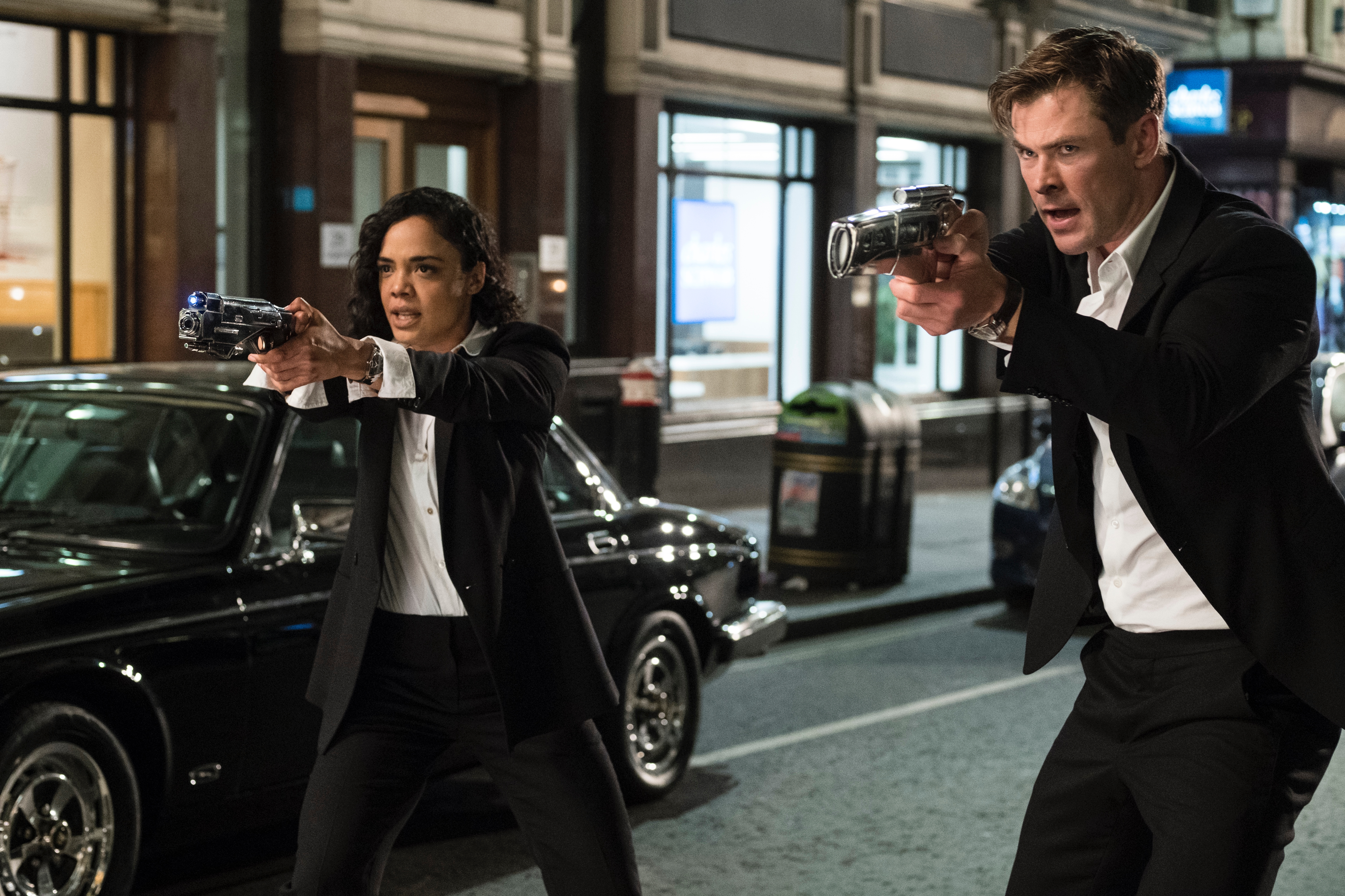 Tessa Thompson and Chris Hemsworth in Men in Black International. Paul Smith designed all the suits for the movie.