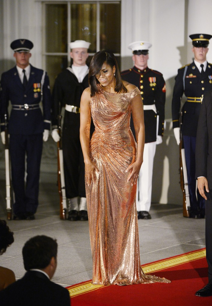 First Lady Michelle Obama at the North Portico of the White House in Washington, DC.Matteo Renzi visits Washington, USA - 18 Oct 2016US President Barack Obama (R) and First Lady Michelle Obama (L)walk out of the White House to greet Italian Prime Minister Matteo Renzi and Italian First Lady Agnese Landini during an official arrival ceremony on the South Lawn of the White House. First Lady Michelle Obama welcomes Prime Minister of Italy Matteo Renzi and Agnese Landini at the North Portico of the White House in Washington, DC. WEARING CUSTOM ATELIER VERSACE