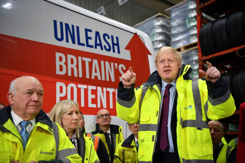 Britain's Prime Minister Boris Johnson talks during a question and answer session, part of a General Election campaign visit to Ferguson's Transport in Washington, England, . Britain goes to the polls on Dec. 12Brexit Election, Washington, United Kingdom - 09 Dec 2019