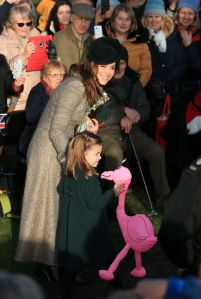 Britain's Catherine, Duchess of Cambridge, center left, speaks with her daughter Princess Charlotte as she holds a pink flamingo while greeting the public outside the St Mary Magdalene Church in Sandringham in Norfolk, EnglandRoyals Christmas, Sandringham, United Kingdom - 25 Dec 2019
