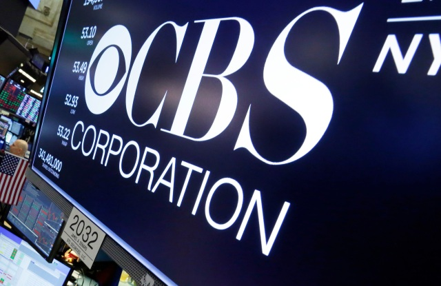 The logo for CBS appears above a trading post on the floor of the New York Stock Exchange, . CBS is suing its controlling shareholder as part of its long-running attempt to avoid a combination with ViacomCBS National Amusements Lawsuit, New York, USA - 17 May 2018