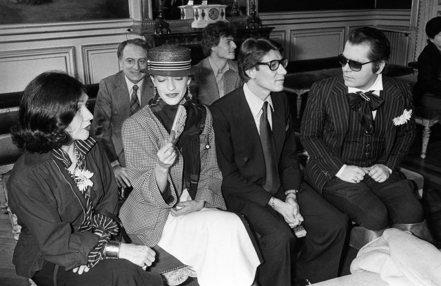 The Paris Big League Fashionmakers: Anne-Marie Munoz of YSL, Lou Lou Klossowski, Yves St. Laurent and Karl Lagerfeld in front, Pierre Berge and Thadee Klossowski behind