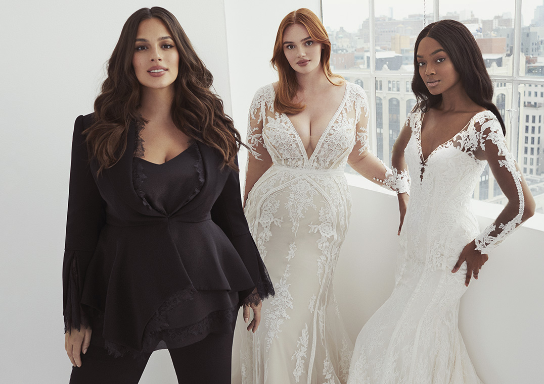 Ashley Graham with models wearing gowns from her collaboration with Pronovias.