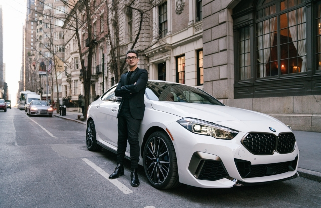 Christian Siriano in front of the BMW 2 Series Gran Coupe.