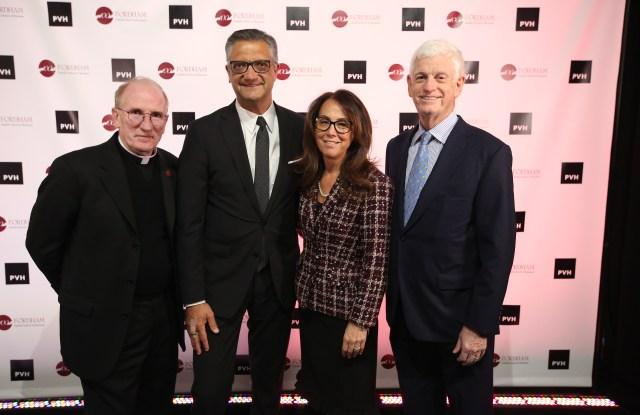 Father Joseph M. McShane, Manny Chirico, Donna M. Rapaccioli and Mario Gabelli.