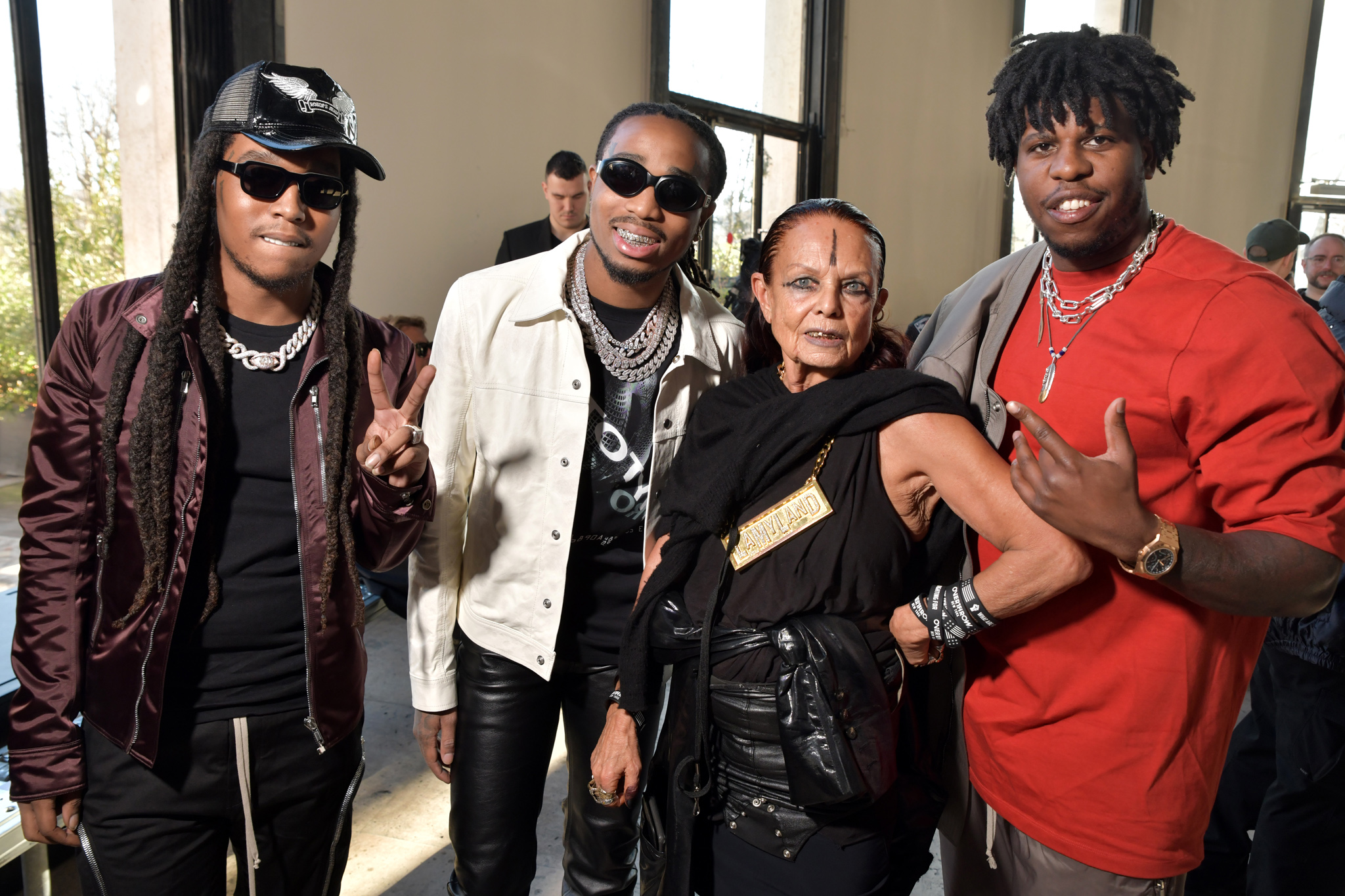 Migos and Michelle Lamy in the front row