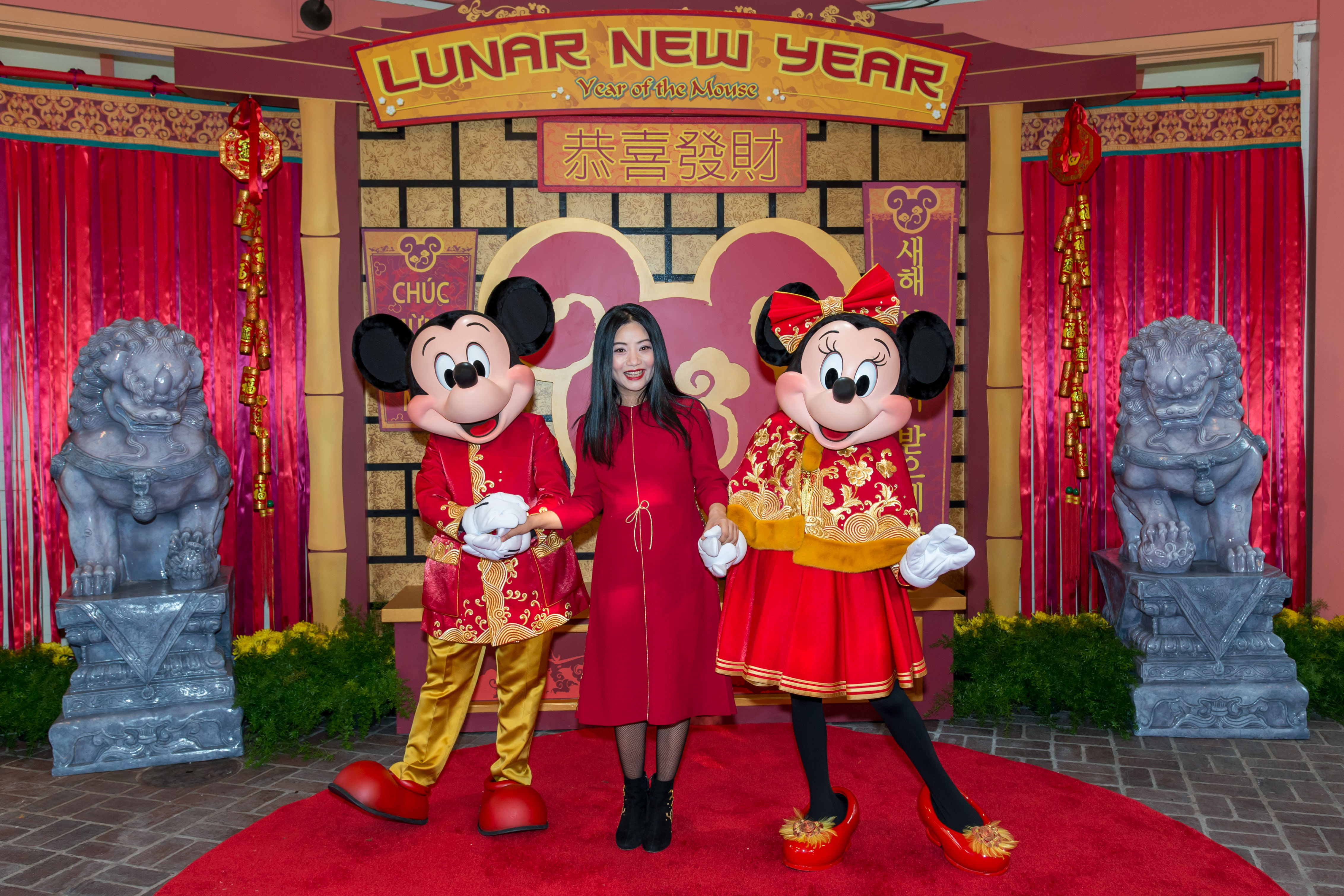 Guo Pei with Mickey and Minnie Mouse in her designs.