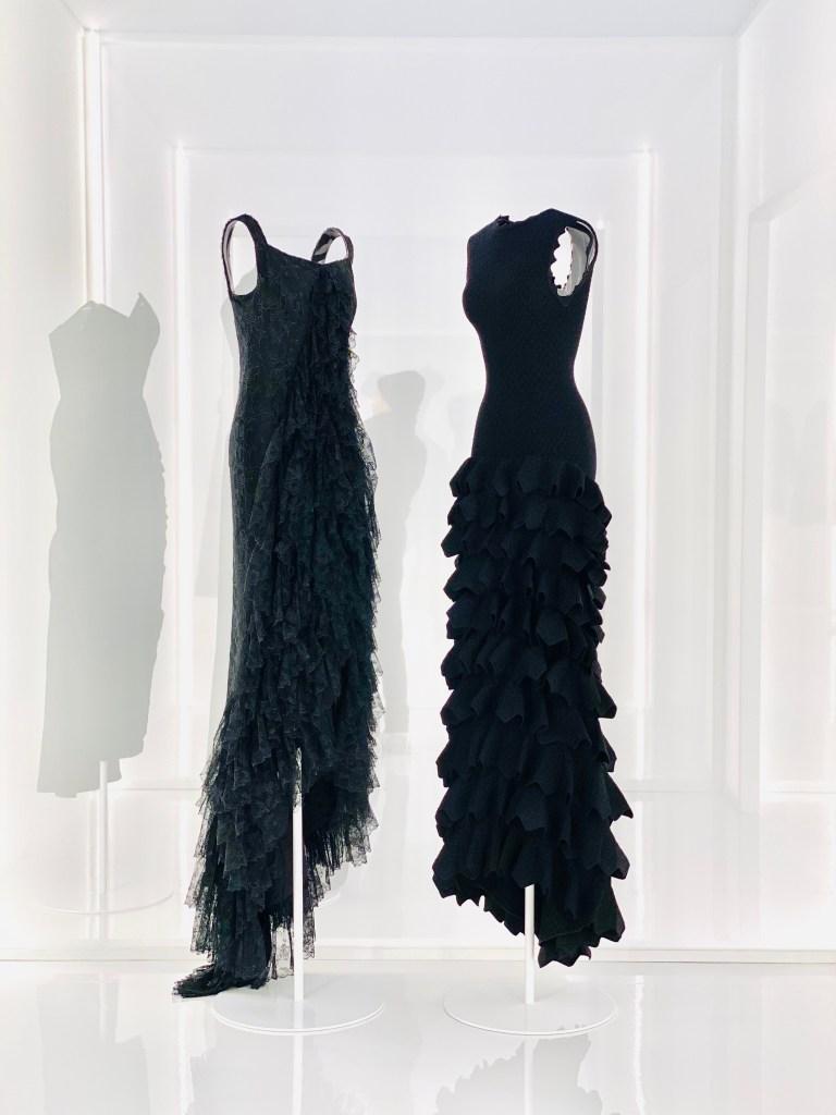 "Dresses by Cristóbal Balenciaga and Azzedine Alaïa in the ""Alaïa and Balenciaga: Sculptors of Shape"" exhibition."