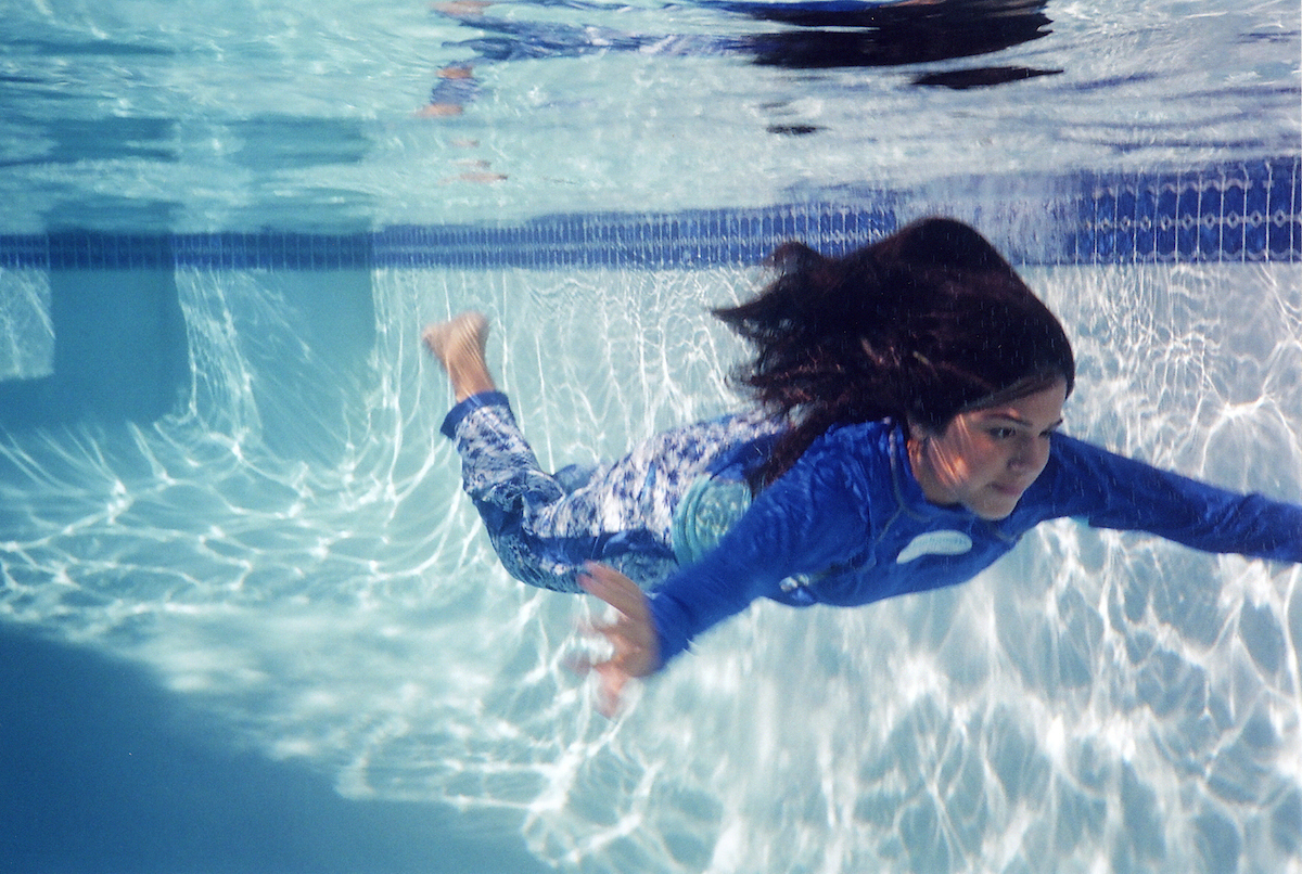 Shereen Sabet (b. Egypt, 1970) for Splashgear, LLC (est. United States, 2005), Ensemble (shirt, pants, and swimhood); Hawaiian Colorway Collection, 2006, Polyester knit; Courtesy of Splashgear, LLC
